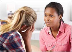 Women speaking to her Doctor